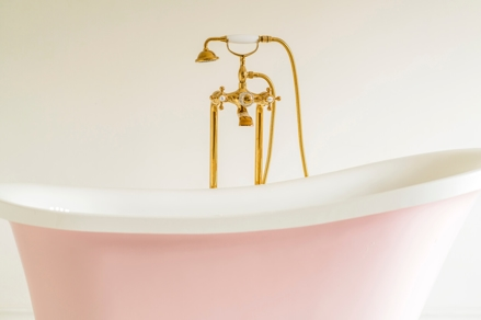vintage pink bathtub with bronze faucet