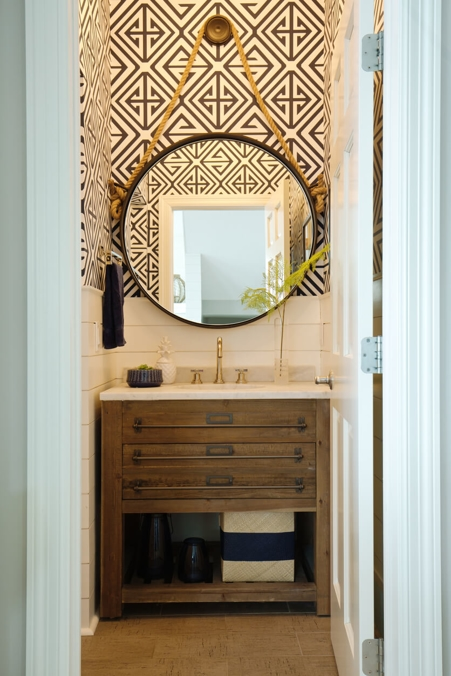 bohemian bathroom with round mirror